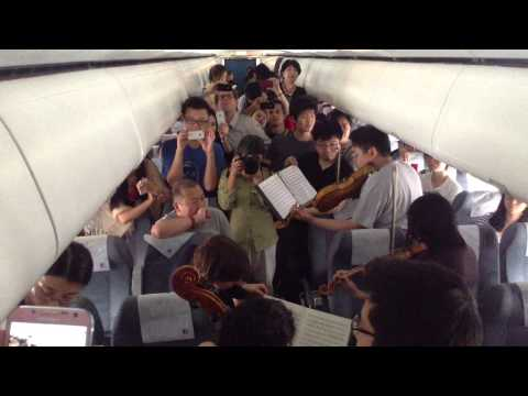 WATCH: Stuck on China tarmac, US orchestra plays concert in plane