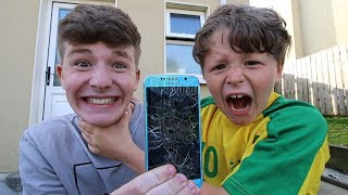 I DESTROYED MY LITTLE BROTHER'S PHONE...his reaction is AWESOME!!! Make sure to subscribe! http://bit.ly/1qwPrp9...