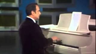 Relax and have a laugh with Victor Borge, great pianist/comedian. If you watch this to 56 seconds, I