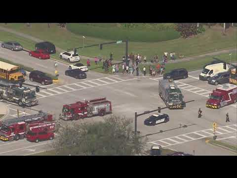 Person being taken out on stretcher at scene of school shooting - Parkland, Florida
