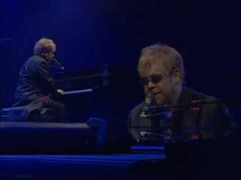 Tekst piosenki Elton John - Weight Of The World po polsku
