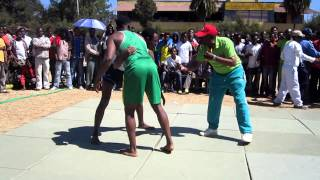 Wrestling Roots - Ethiopian Tigel Wrestling. 72 Kilos. Anbessa Kahsay (green) Vs. ?