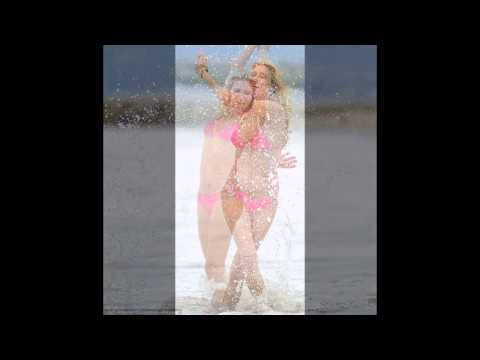 Brandi Glanville shows Rimes up in a tiny pink bikini as she frolicks alone on the beach