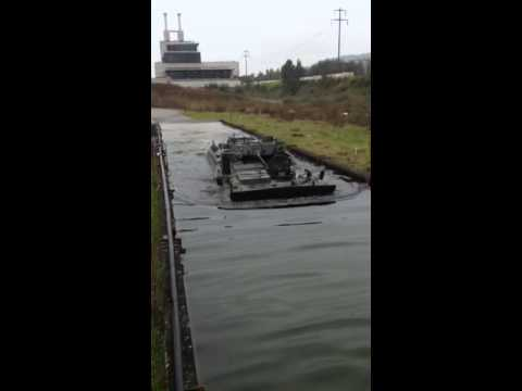 Piranha 3 armored personnel carrier swimming at test site in Switzerland