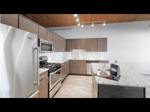 Tour a large one-bedroom plus den at The Lofts at River East in Streeterville