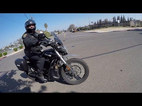 Dancing Motorcycle Cop Hiding Under Tree