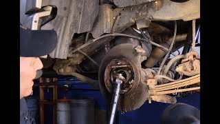 In this video I will show you how to replace the rear axle seal and parking brake shoes I will show you how to remove the rear axle from the truck.This is a 2004 Ford Explorer.