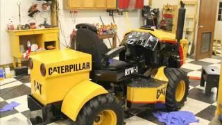 8. Mini Caterpillar 4 wd articulating tractor