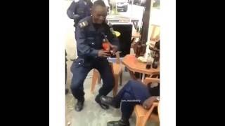 Funny Video: All Work &No Play. Policeman Dancing And Drinking On Duty