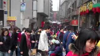 Nanning China  city photo : The streets of Nanning China. blind woman music. poor digin