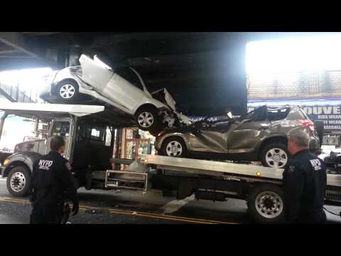 Truck driver in New York City destroys Toyotas after misjudging a bridge