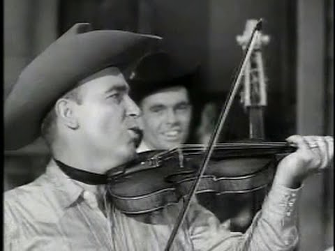 Will's - Bob Wills shows his master showmanship as both bandleader and musician in this short known as Fiddlin' Man. Backing the king of western swing, the gum-chewin...