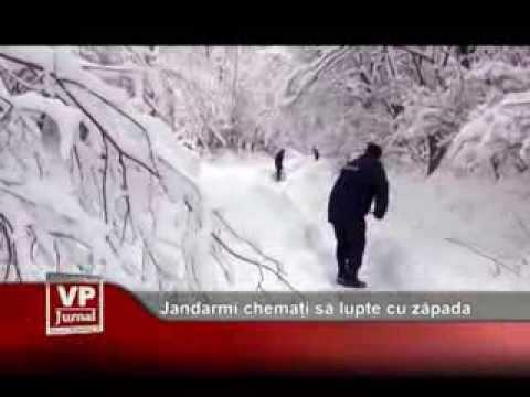 Jandarmi chemați să lupte cu zăpada