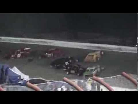 Racer flips over wall during crash