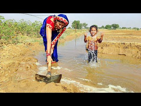 Desert Irrigation Life   Women watering in farm   enjoyed in Farm Hanumangarh Bhukarka #shubhjourney