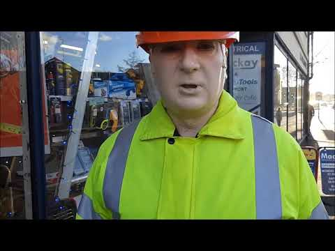 mannequin-man performming as a Living Mannequin: Mannequin-man reprising the role of Dickie Mackay, the Dickies work wear clothing sponsored mannequin that stands outside Mackays in Cambridge through rain shine and snow for Mackays on 29/11/2018