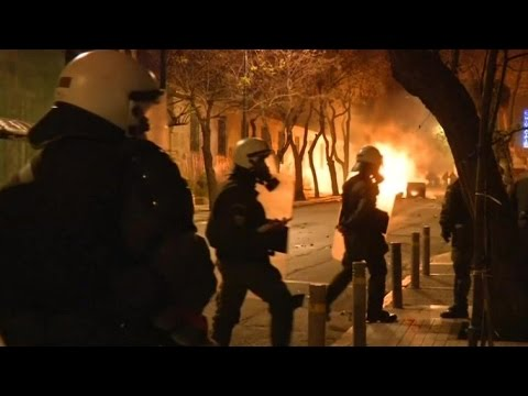 Anti establishment protesters clash with police and torch bus in Athens