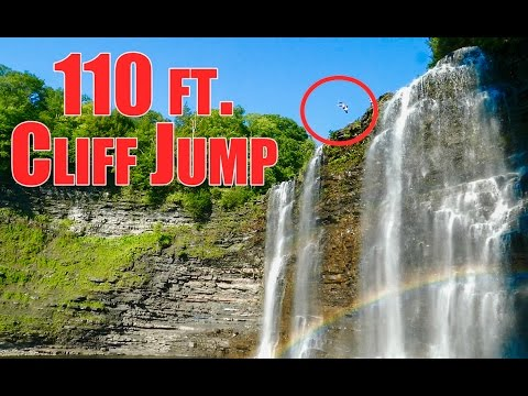 MASSIVE CLIFF JUMP INTO A RAINBOW