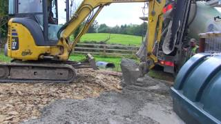 Mini-Digger being used to help pour a foundation