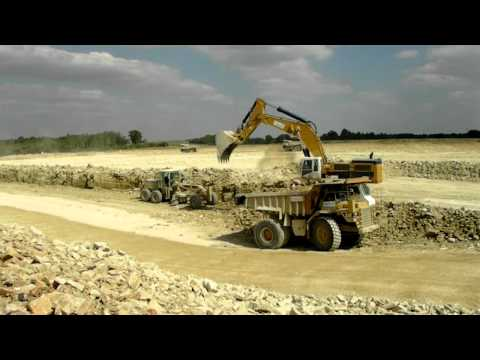 CAT 390DL loading CAT 773D and E from V.C.T company
