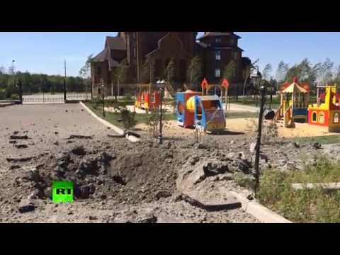 footage - Wooden church and a nearby playground got under shelling in Gorlovka on July 29. A local woman was heavily injured as the shell also hit the bus station in front of the church. Gorlovka has...