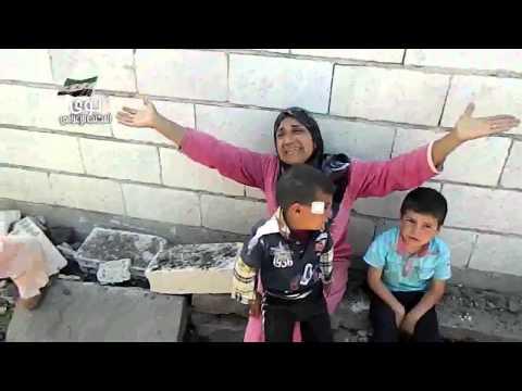 بكاء أم لشهيدة و اربعة اطفال جرحى نتيجة القصف بالبراميل المتفجرة علي نوي
