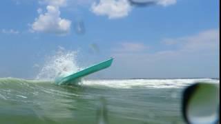 Solo Skiff through the Surf