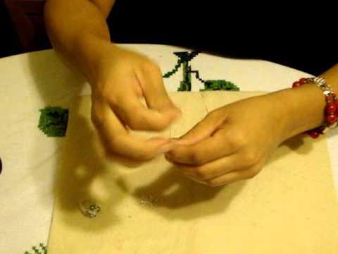 Como hacer Anillo de perlas .2