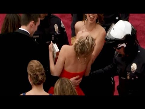 Falls - Post to Facebook: http://on.fb.me/OSaYGV Share on Twitter: http://bit.ly/1hWJBDP Ellen Jokes about Jennifer Falling: http://bit.ly/1kLWxOw More Celebrity New...