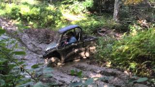4. John Deere Gator RSX 850i in the Mud - Defeat