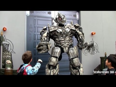 megatron - [HD] HILARIOUS and Angry Talking Transformers - Megatron POKING fun at guests. Kid defending himself after Megatron poked fun at him. Interactive Talking Tra...