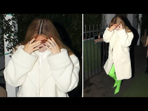 Kylie Jenner Stuns In Lime Green Boots And White Mini-Dress At Giorgio Baldi