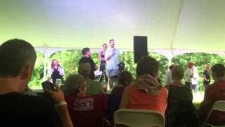 Nadia Bolz-Weber, Krista Tippett at Wild Goose 2013. Taking a break in the interview to sing while a train passes by.