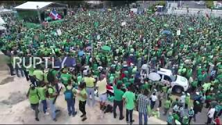 Tens of thousands participated in a 'Green March' against government corruption in Santo Domingo, Sunday. The protesters ...