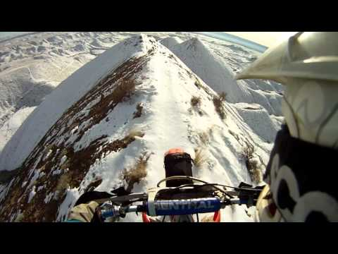 Driving Motorcycle On Snowy Mountain Top