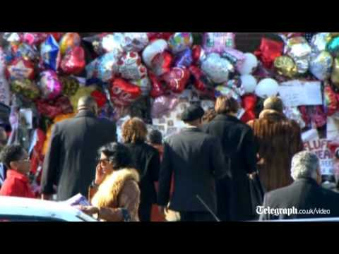 Whitney Houston's coffin arrives in church