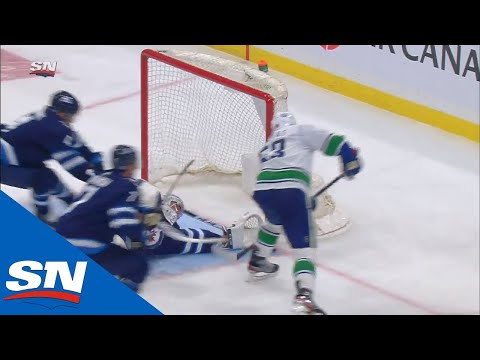 Connor Hellebuyck Denies Bo Horvat On The Doorstep With Sprawling Save