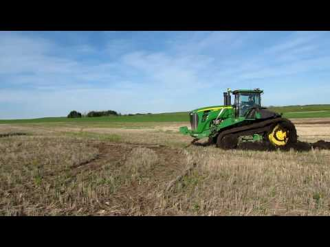 John Deere 9630T Stuck in mud and getting a pull