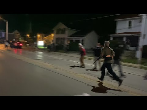 Video shows Kenosha shooting suspect running with rifle, shooting into crowd