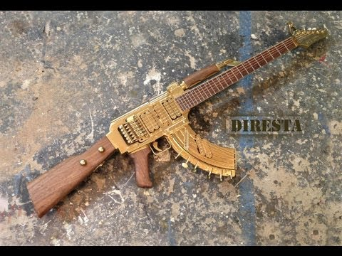 guitar - I made this AK47 Guitar for Wyclef Jean. Enjoy! PART 2: Click here to see Wyclef discuss the creation of the GaTTar http://www.youtube.com/watch?v=6XgmjHrTJG0.