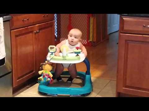 Baby excited about learning how to walk in his walker