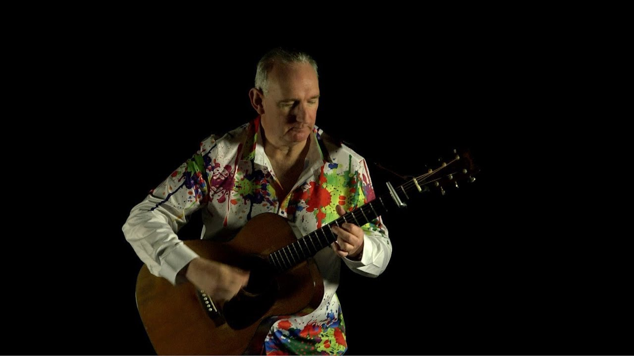Acoustic guitarist Tony Skinner strums the heck out of a 1941 00018 vintage Martin acoustic guitar