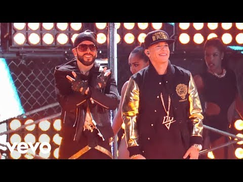Yandel - Music video by Yandel feat. Daddy Yankee performing Moviendo Caderas. (C) 2014 Sony Music Entertainment US Latin LLC.
