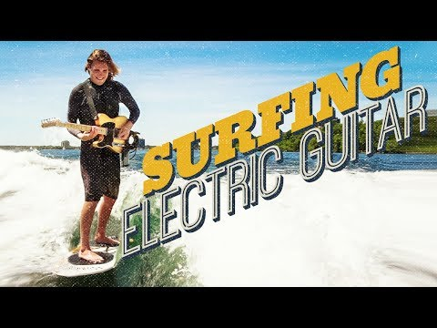 Guy Surfing AND Playing Electric Guitar! – JamUp App [Official Video]