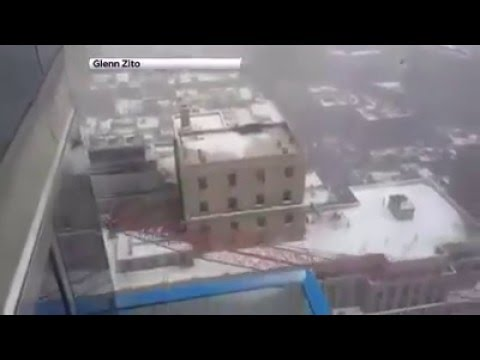 CRANE COMES TUMBLING DOWN IN NYC.