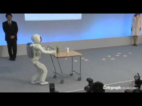 Honda - Honda demonstrate the revamped Asimo robot, making the childlike machine run, hop around as well as serve drinks to show how the humanoid is now smarter and ...