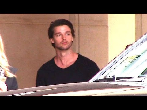 Patrick Schwarzenegger Waits For His Ride Following Business Meeting