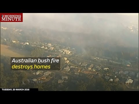 Australian bush fire destroys homes.