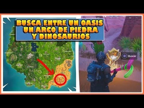 BUSCA ENTRE UN OASIS UN ARCO DE PIEDRA Y DINOSAURIOS - DESAFIOS SEMANA 2 - FORTNITE