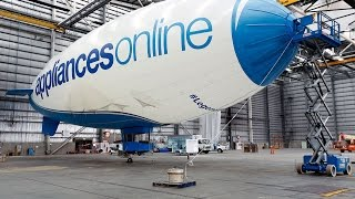 timelapse of the appliances online legendary blimp being constructed in a hangar appliances online